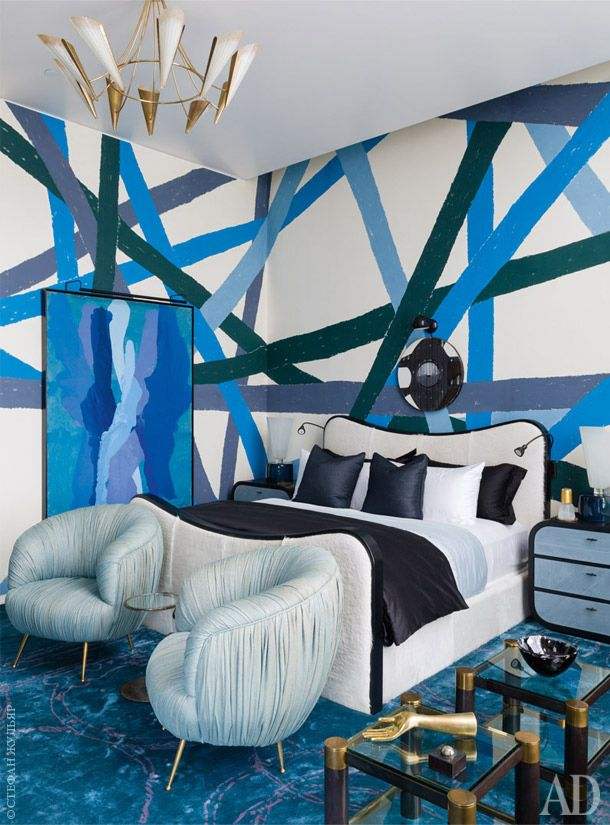 Retro, groovy Kelly Wearstler bedroom. Vintage furniture and a bright blue color scheme grab your attention immediately.