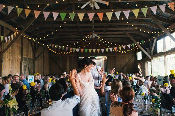 Note.. Bunting & lights looped...Puck's Farm wedding - photo by Sara Wilde http://ruffledblog.com/pucks-farm-wedding