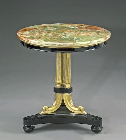 A Late William IV Parcel Gilt And Ebonized Center Table Second Quarter  Century The Circular Variegated Green Marble Top Supported On Lotus Carved  Triple ...