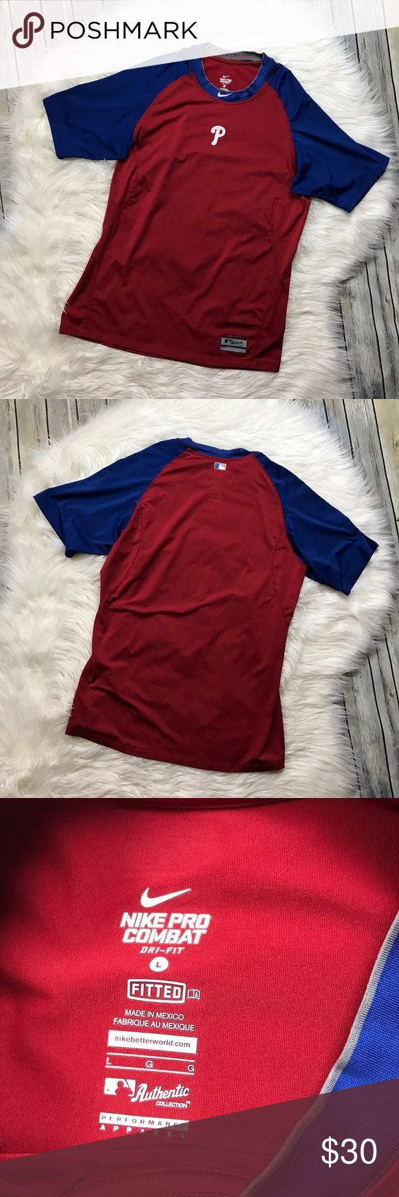 "Nike Pro Combat Men's Philadelphia Phillies Tee Very nice mens short sleeve red and blue Phillies shirt. Gently used with no flaws. 84% polyester, 16% spandex.   Measurements laying flat (without stretching)—  Armpit to armpit: 21.5"" Length, shoulder to hem: 28.5"" Nike Shirts"