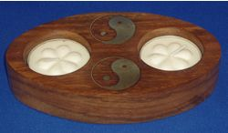 Wooden Yin and Yang Tea Lite Holder from Absolute Angels A superb oval of polished wood containg two tea lites Inlaid with brass two Yin and Yang symbols  £2.25