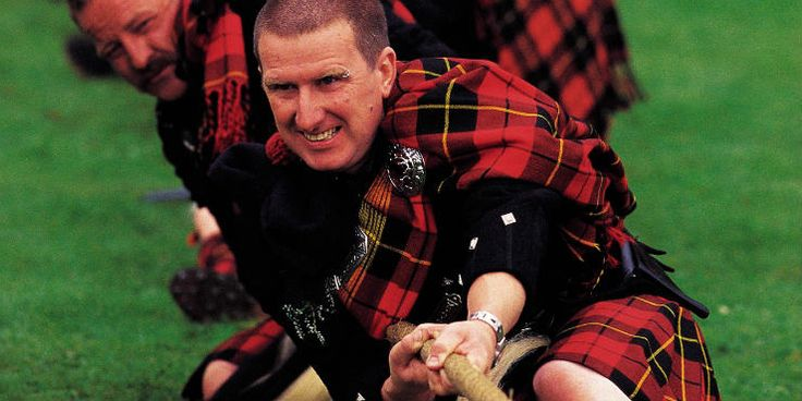 Members of the Wallace clan take part in the tug o' war competition at Lonach Highland Gathering and Games, Aberdeenshire