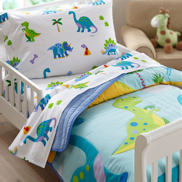 Dinosaur Land Toddler Comforter - Dinosaurs have returned! Olive Kids Dinosaur Land will make kids roar with per-historic delight. Dinosaurs, including a Brontosaurus and T-Rex inhabit a world filled with volcanoes, primitive trees and dino footprints! Greens and blues are complimented with splashes of bright color for even more fun.