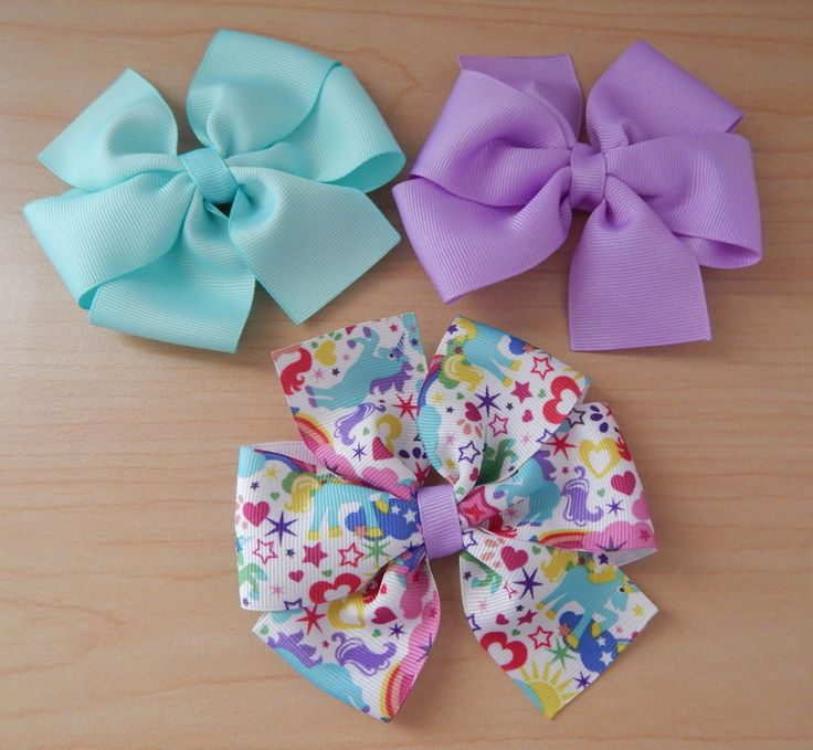 A beautiful and colorful combo of three hair bows for girls. Perfect for all year round! This hair bow set includes: a purple hair bow, an aqua hair bow and a colorful hair bow with ponies, hearts, st
