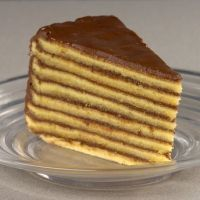 Smith Island Cake - Group Recipes.   I made this cake last year for my Mom's birthday and it was 100% AWESOME! Follow the recipe to the letter and you'll be amazed! Make sure you re-grease and flour the pans each time you start new layers so that they don't stick to the pan! -er