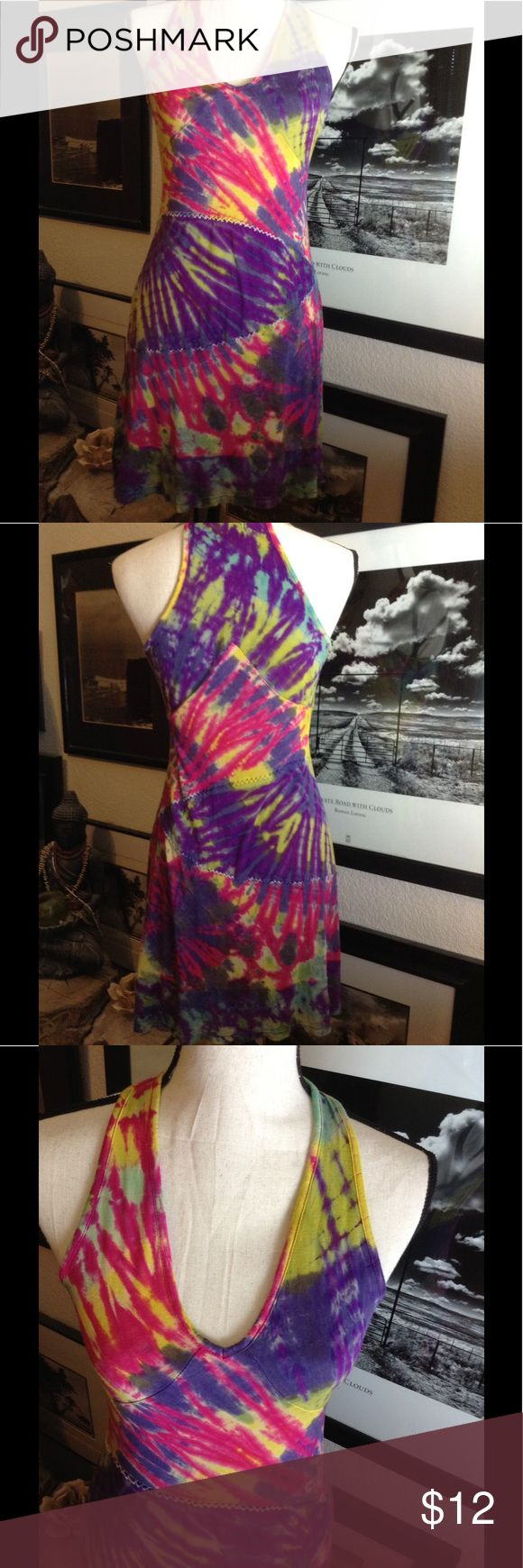 Hippie festival dress Picture this dress with a pair of birkies on a hot summer day.  Purple, green, yellow, red, racer back, pull over soft stretch, v neck. Note there is a small prick in fabric at the bottom, does not deter from its beauty. RisingINTERNATIONAL Dresses Mini