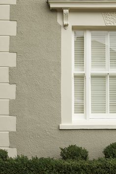 House painted in Farrow & Ball Masonry Paint - Light Gray rendering with bricks and window surround in Off-White and wooden window frame in ...