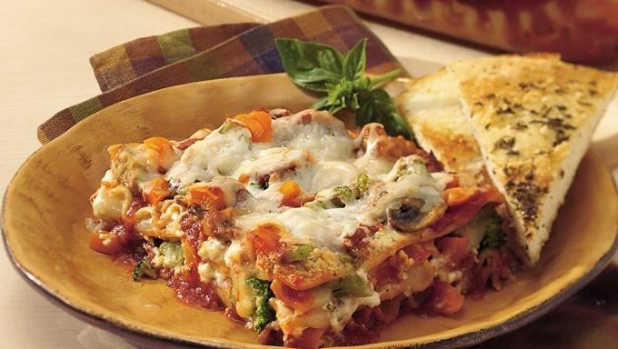 In search of an easy meatless dish? Try this lighter lasagna with creamy ricotta blended with fresh and frozen vegetables and prepared sauce.