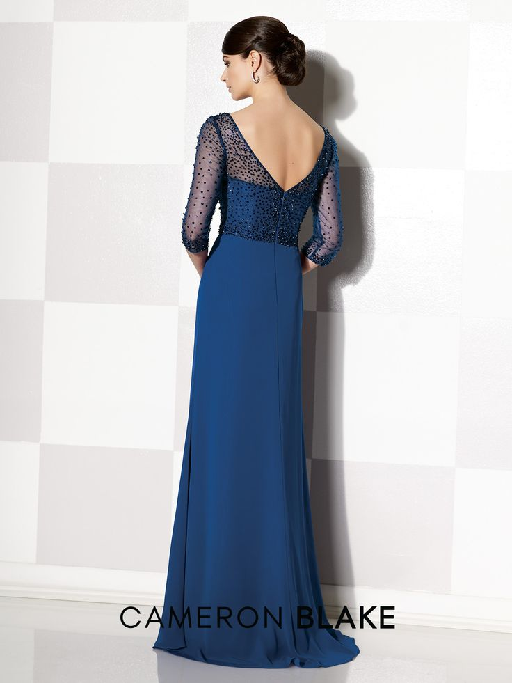 Chiffon slim A-line gown with hand-beaded illusion three-quarter sleeves and front and back V-necklines, sweetheart bodice, beaded empire bodice, center gathered skirt, sweep train. Sizes: 4 – 20, 16W – 26W Colors: Navy Blue, Mink, Dark Plum, Teal, Periwinkle