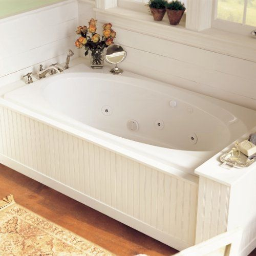 Drop-in tub with paneled framing
