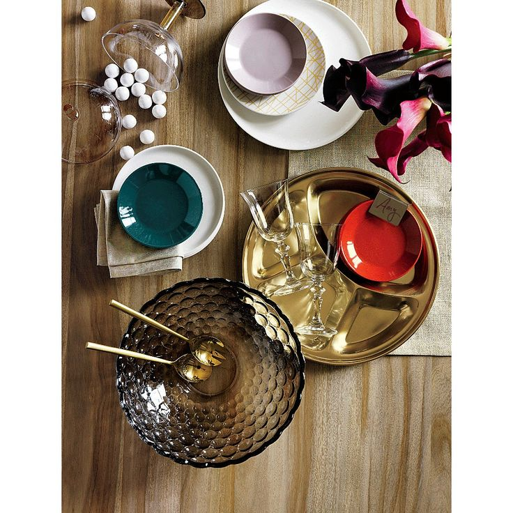 Shop amuse appetizer plates.   Vivid rounds of glaze-dipped stoneware serve up starters in a fun handheld size.  We love all three as a modern pop of color for parties/holidays.