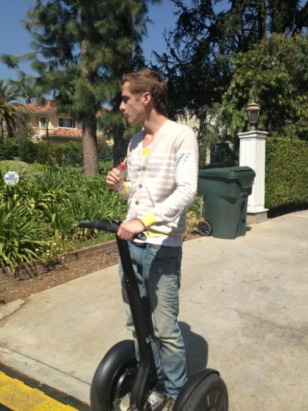 Kendall on a segway...big time belair... CAN WE JUST APPRECIATE THAT HE IS EATING A POPSICLE LIKE A LITTLE KID? LOVE HIMMMMMMM!