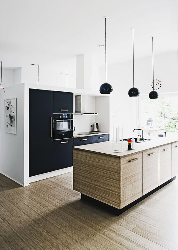 Don't love the design but like the colour combos of wood, white and black.... classy, calming and crisp.