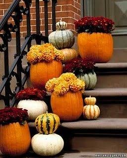 fall porch decor; mums in pumpkins