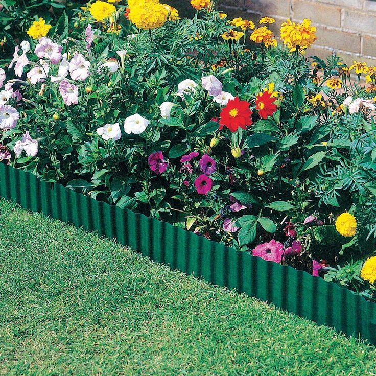 Install plastic edging so that only a half or third of the top rounded edge is visible. #gardendesign #gardening #edge