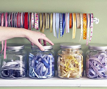 Use ribbon as a decorative accent. Placing scraps of ribbon in glass canisters is a great way to keep scraps tidy and add color to your space. For your favorite rolls, hang a small rod and place ribbon across, sorting by color or pattern.
