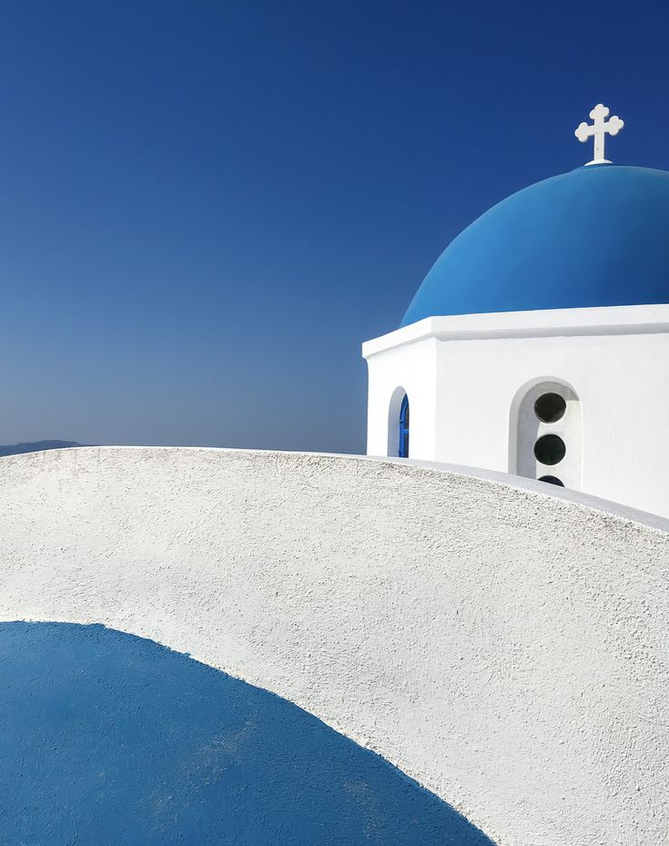 Blue domed church in Oia. Sometimes it helps to take another look at something from a different perspective. You never know what you may find ;-)