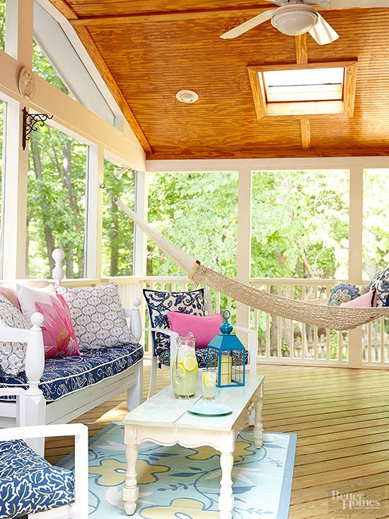 A glam color combo meets cottage style in this screened porch. Posh fuchsia and navy blue add pizazz to the sweetly vintage white furniture. And that hammock? Perfection. Secret to Pretty: A wood ceiling and floor binds the room in and helps the lofty space feel cozier.