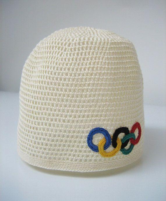 Uncinetto cappello giochi olimpici. Tappo con olympic di linzes