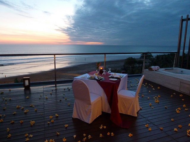 Dinner for two served on the balcony at Anantara Penthouse