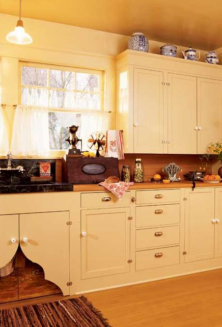 A reproduction 1914 American Bungalow kitchen - cabinets formerly went to the ceiling; they were dropped, period-style, which left room for the display of blue and white china. The old telephone at right, found at the Portland Antiques Expo, still functions in today's world.