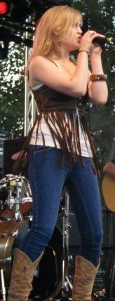 Carly McKillip jeans, fringe vest, and cowboy boots (One More Girl's performance at the 2009 Rockin' River Music Fest)