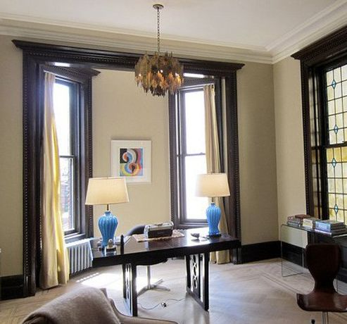 I like the dark trim with wall color. Interesting that top molding is white