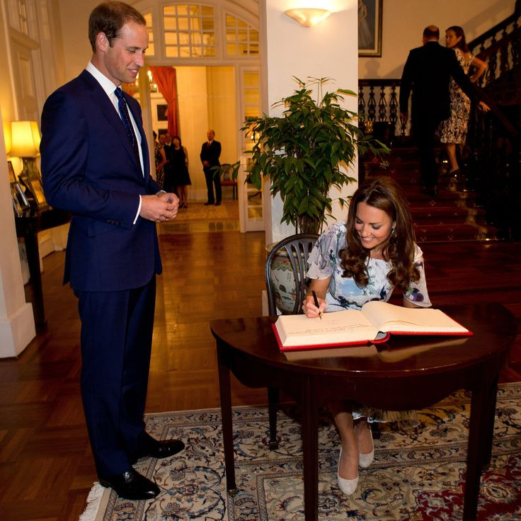 Prince William: Prince William smiled as Kate Middleton signed a guest book during a British gala at Eden Hall in Singapore.