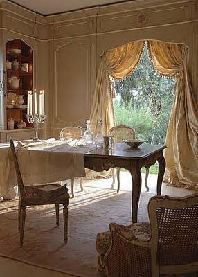 I personally love the use of drapery to frame doorways or section off a dining room to make it more intimate.