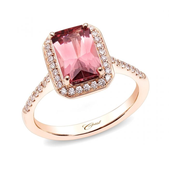An exquisite ring featuring a 2.01CT pink tourmaline surrounded by a diamond halo and shank. Set in 14K rose gold.