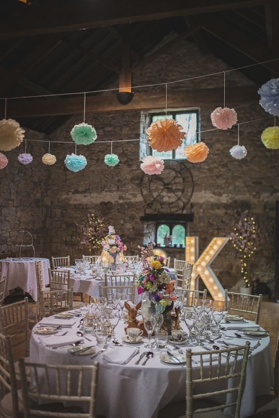 reception room with paper pom poms and illuminated letters / http://www.himisspuff.com/pom-poms-decor-ideas-for-your-wedding/5/