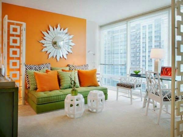 orange living room paint colors in combination with green furniture