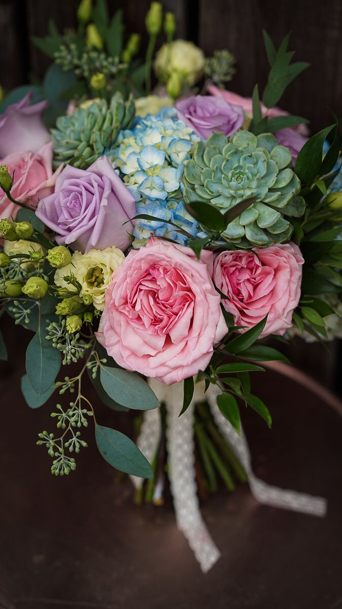 hand tied bridal bouquet in pastel colours with pink ohara garden roses