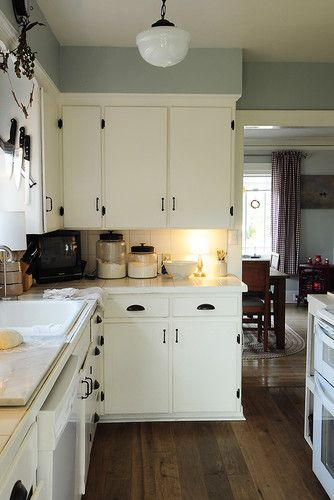 I like the paint color and hardware in this kitchen...maybe a little lighter shade for our tiny one though