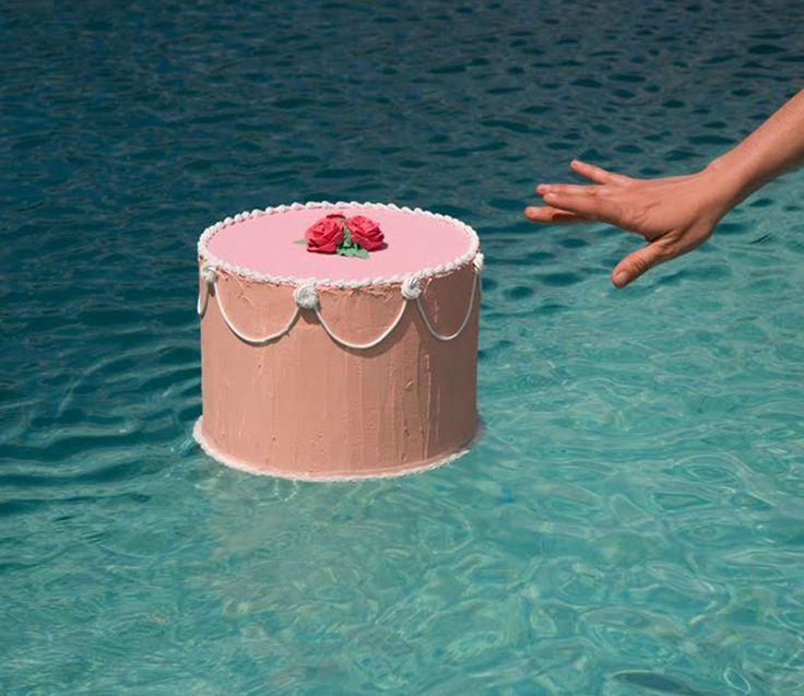nine fake cakes floating in nine bodies of water by jacinda russell