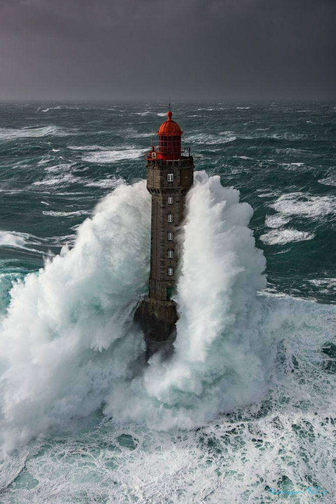 Seascape - Lighthouse - La Jument lighthouse in Brittany, France at Quessant Island, during the storm Ruzika, 50 knots of wind and a swell furthermore of 10m this day.