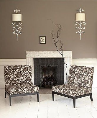Great wall colour, lamps and chairs. What's with the tiny picture? It needs a big old white mirror over the fire place