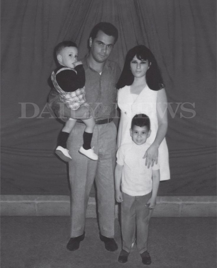 "This photo from 1970 shows John Gotti holding his son Frankie Gotti and standing beside his wife Victoria Gotti with John (Junior) Gotti standing in front at Lewisburg Federal Penitentiary. The photo is featured in John (Junior) Gotti's book ""Shadow of My Father."""