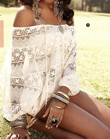White crochet top with white shorts and lots of accessories, bohemian style