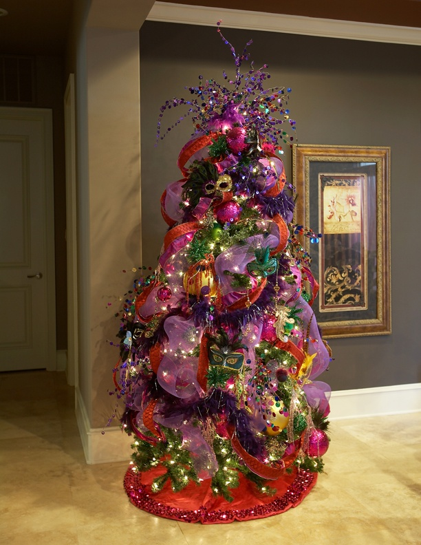 Fantastic Mardi Gras tree with glitter masks, deco mesh and floral sprays