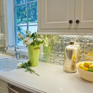 Use tin tiles for backsplash with lights underneath for reflection