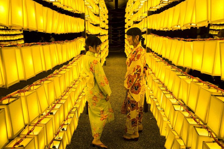 Women wearing kimonos walk between lit paper lanterns during the Mitama Matsuri summer festival at the Yasukuni Shrine in Tokyo on July 13. The four-day traditional festival takes place during Tokyo's Bon period in July, attracting about 300,000 visitors according to the shrine.