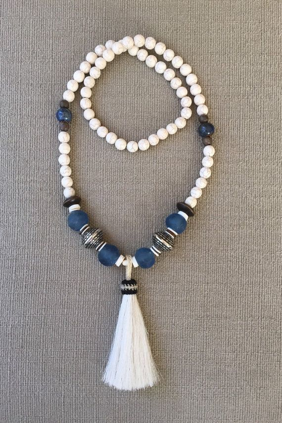 This white horse hair tassel bead necklace will be your favorite accessory! The tassel is made from real horse hair, and the beads consist of African