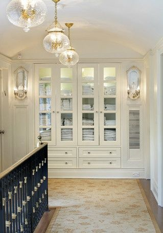 built-in linen storage - a great idea for a dead-end wall---love this!
