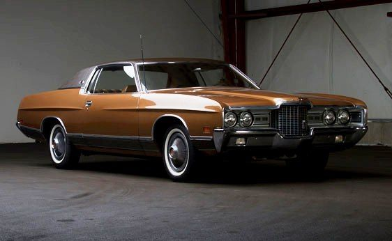 1971 Ford LTD 2 Door. Showing just 15,969 miles driven over the past 43 years, this LTD is one of the best quality examples to be found. It is finished in yellow gold with a mocha padded roof.