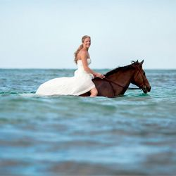 Trash the dress session after the wedding, wearing your dress bareback in the ocean