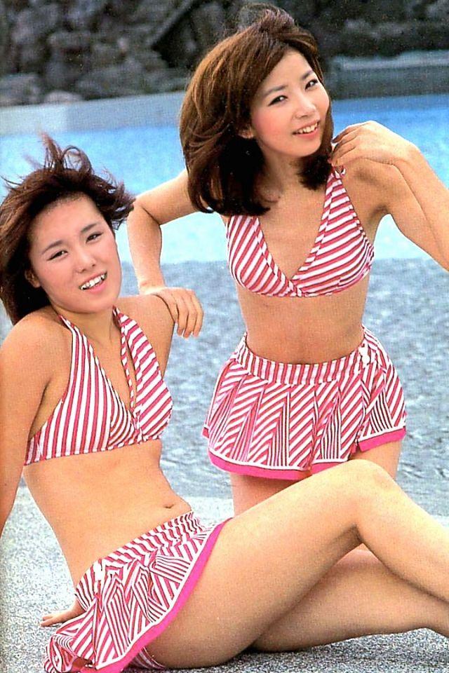 """ピンク・レディー Pink Lady; Mitsuyo Nemoto,""""Mie"""", and Keiko Masuda, """"Kei"""", famous for their string of hit singles in the late 70's and early 80's, including """"Nagisa no Sinbad"""", """"Wanted,"""" """"UFO"""" (their biggest-selling single, with 1.95 million copies sold), """"Southpaw, and """"Monster""""."""