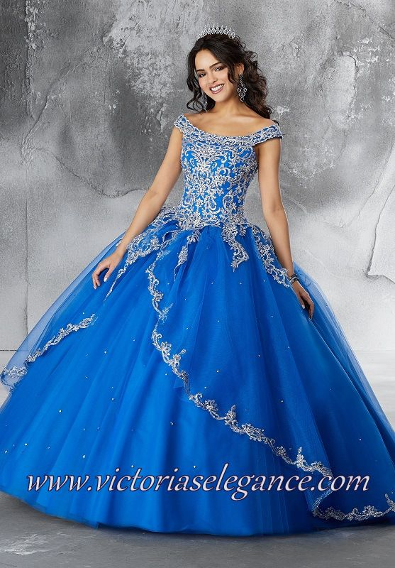3ae6955ad86f This Mori Lee Vizcaya 89191 gown is adorned with metallic embroidered  appliques, with an off-the-shoulder neckline and a lace-up keyhole back.  The ballgown ...
