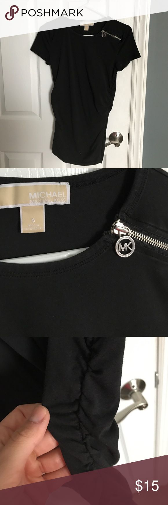Michael Michael kors black tshirt Black shirt with shirring on the sides. Zipper detail on top. Size small. Fitted top, on the longer side. MICHAEL Michael Kors Tops Tees - Short Sleeve