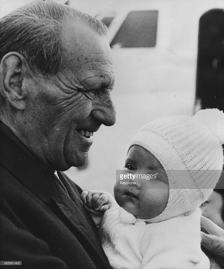 Prince Frederick of Denmark holding his granddaughter Princess Alexia of Greece as they arrive in Copenhagen, November 2nd 1965.